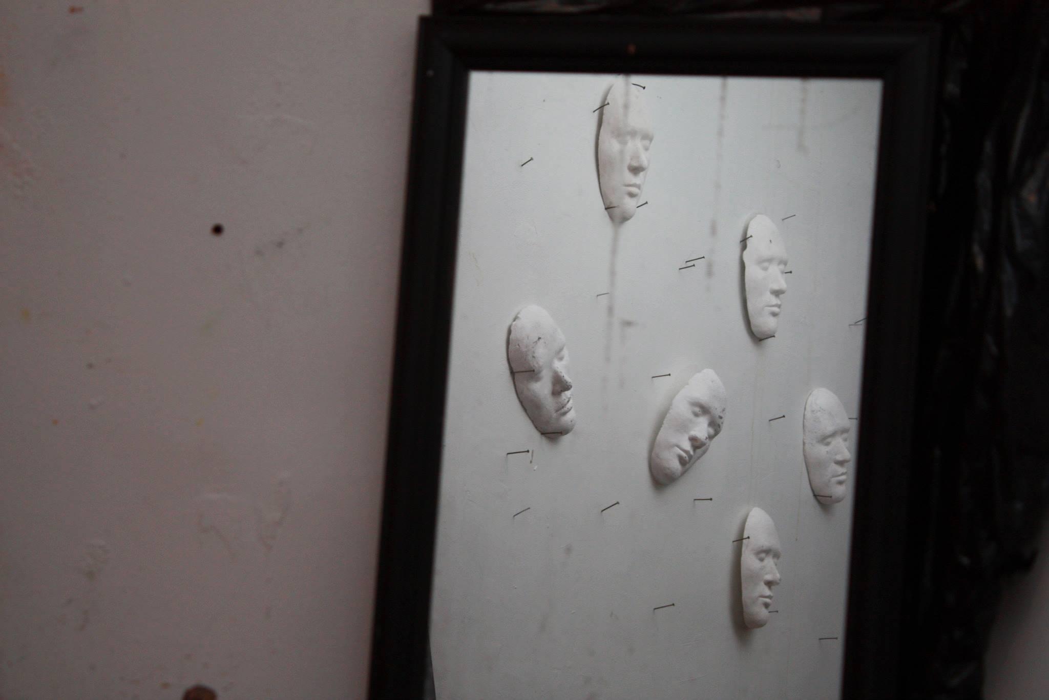 white masks in a mirror set design